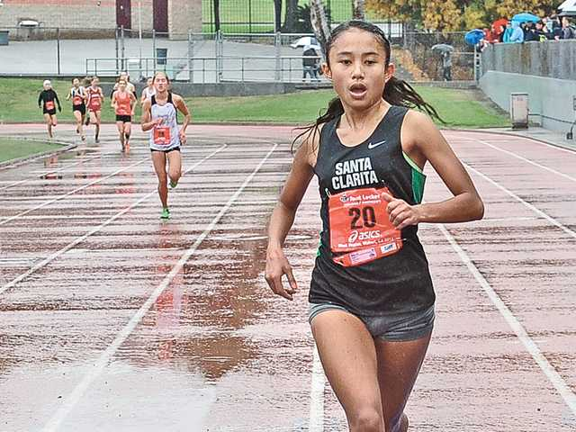 Samantha Ortega runs at Mt. SAC on a rainy Saturday.