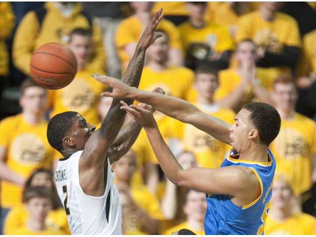 UCLA's Kyle Anderson, right, passes the ball past Missouri's Tony Criswell on Saturday in Columbia, Mo.