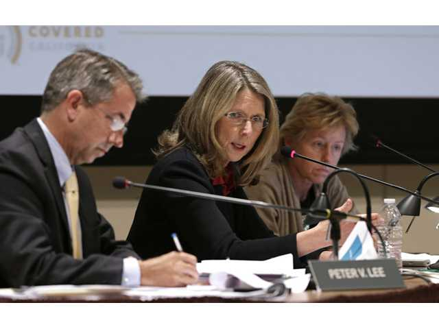 Diana Dooley, center, chairwoman of California Health Benefit Exchange Board of Directors speaks during a meeting in Sacramento.
