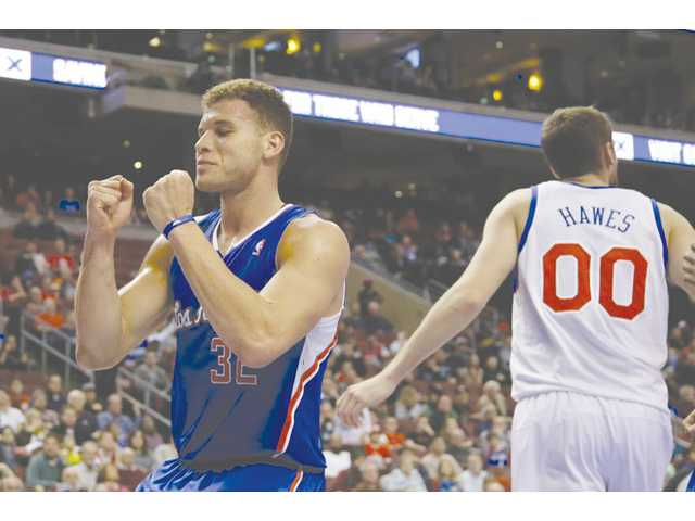 Los Angeles Clippers player Blake Griffin, left, reacts during a game against the Philadelphia 76ers on Monday in Philadelphia.