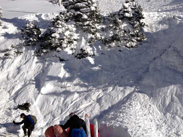 Rescuers dig out a woman buried in an avalanche she triggered. She survived by deploying a special air bag and other skiers were able to quickly dig her out. Joseph Campanelli/AP Photo