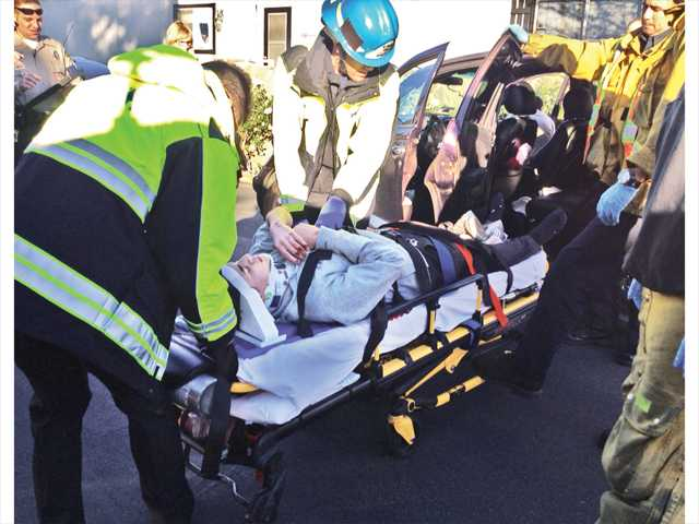 Emergency responders move a boy on a gurney after he was hit by a car in Canyon Country on Tuesday. Signal photo by Jim Holt.