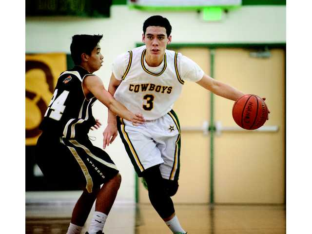 Canyon's Ben Taufahema (3) dribbles the ball past a Panorama High defender during Tuesday night's game at Canyon High.