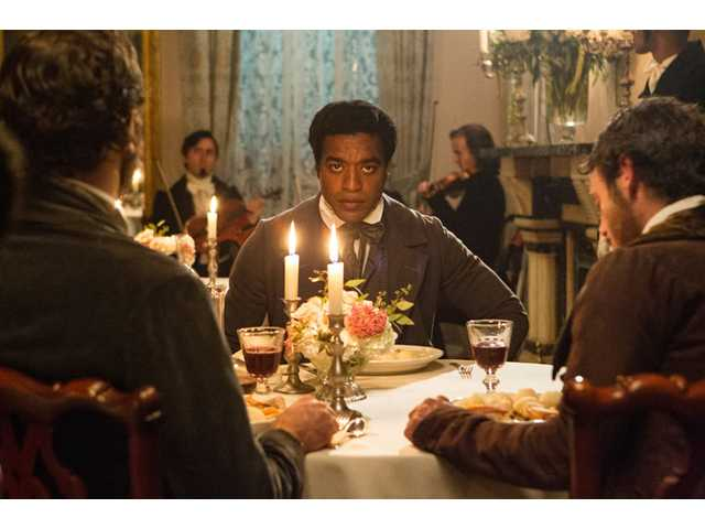 "This film publicity image released by Fox Searchlight shows Chiwetel Ejiofor in a scene from ""12 Years A Slave."""