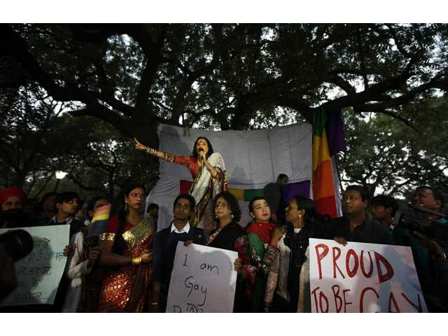 A gay rights activist delivers a speech during a protest against a court ruling in India in New Delhi, India on Wednesday.