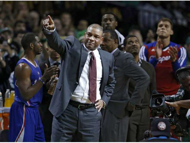 Los Angeles Clippers head coach and former Boston Celtics head coach Doc Rivers acknowledges fans during a video tribute to him in Boston on Wednesday.