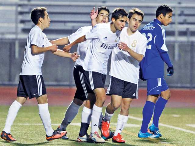 The Valencia soccer team celebrates after Anthony Alfonso scores a goal against Clovis High at Valencia on Thursday.