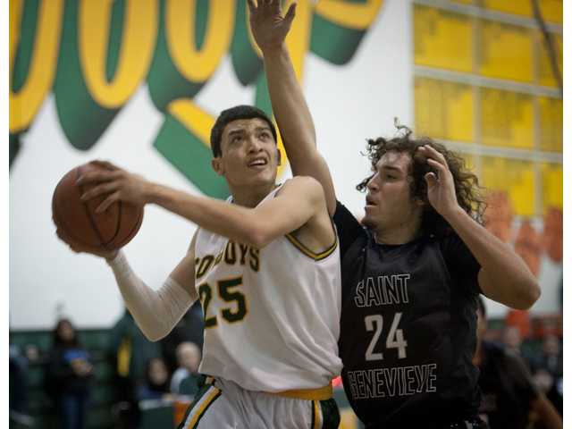 Canyon's Marc Cabrera tries to pass a St. Genevieve defender for a layup during Friday night's game at Canyon High.