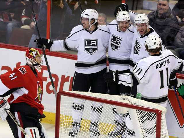 Los Angles Kings' Drew Doughty and Dwight King (74) and Jeff Carter (77) and Anze Kopitar (11) celebrate a goal on Saturday in Ottawa.