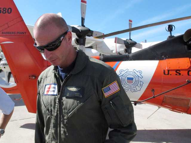 U.S. Coast Guard aviation survival technician P.J. Ornot speaks about a Molokai plane crash rescue to reporters at Coast Guard Air Station Barbers Point in Kapolei, Hawaii on Thursday.