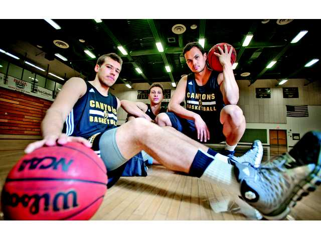 Ilya Ilyayev (left), Zach Davis (middle) and David Horst of the College of the Canyons men's basketball team.