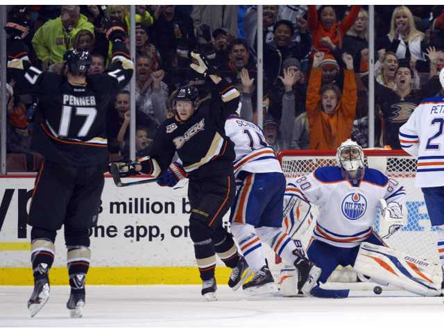 Anaheim Ducks left wing Dustin Penner, left, celebrates his goal with right wing Corey Perry on Sunday in Anaheim.