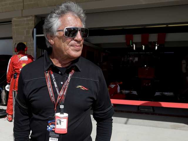Former race car driver Mario Andretti waist for the start of the Formula One U.S. Grand Prix auto race at the Circuit of the Americas, Sunday, Nov. 17, 2013, in Austin, Texas.