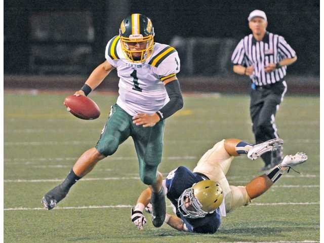 Canyon senior quarterback Cade Apsay (1) was voted the Foothill League Player of the Year by the league's coaches.