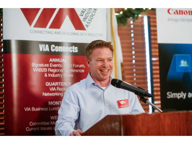 Chris Chapleau, of American Business Machines, was sworn in as the 2014 chairman of the Valley Industry Association board of directors, Tuesday at the Valencia Country Club. He is preceded by VIA board member Alan DiFatta.