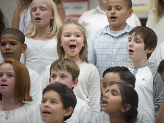 A chorus of elementary school children from the Newhall School District perform for the 2013 Winter Concert on Tuesday at Pico Canyon Elementary School. The school district is working to raise $10,000 to support music programs. The amount will be matched by the Henry Mayo Newhall Foundation. Signal photo by Charlie Kaijo.