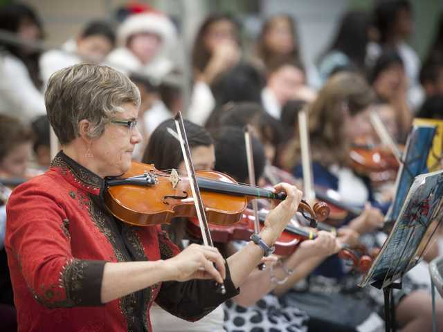 Tara Speiser, instrumental conductor, plays the violin along with orchestra members from the Newhall School District for the 2013 Winter Concert on Tuesday at Pico Canyon Elementary School. Signal photo by Charlie Kaijo.