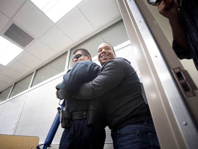 VA work study student Corteny Thomas tackles COC campus safety officer Frank Sanchez during a training exercise on the Valencia campus on Wednesday. Signal photo by Charlie Kaijo