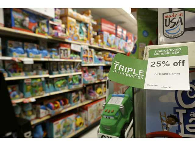 "A ""Triple Doorbuster"" sale sign is placed at the toys section in Kmart during Thursday shopping in New York."