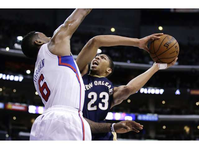 New Orleans Pelicans' Anthony Davis, right, goes up for a basket against Los Angeles Clippers' DeAndre Jordan on Wednesday in Los Angeles.
