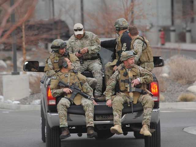 SWAT team members are trucked to the Reno, Nev. medical center where a lone gunman shot and injured four people. Reports are that he had a history of mental illness.