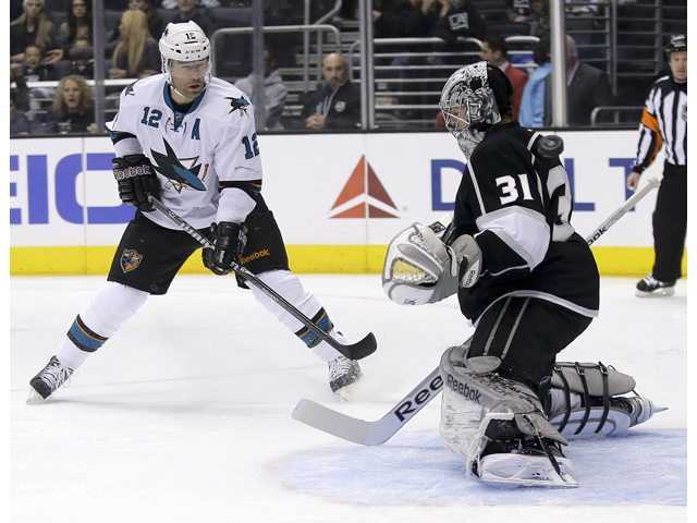 Los Angeles Kings goalie Martin Jones, right, blocks a shot by San Jose Sharks center Patrick Marleau in Los Angeles on Thursday.