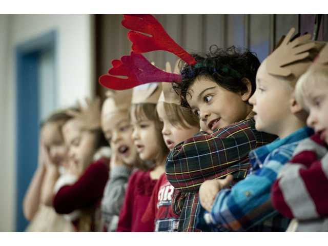 "Preschool children sing ""Away in a Manger."""