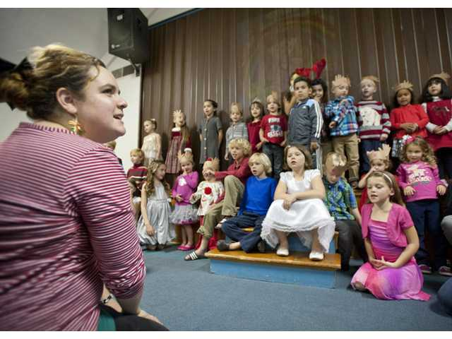 Dyana Vos, director of the Little Shepherd's Nursery School, conducts the children.