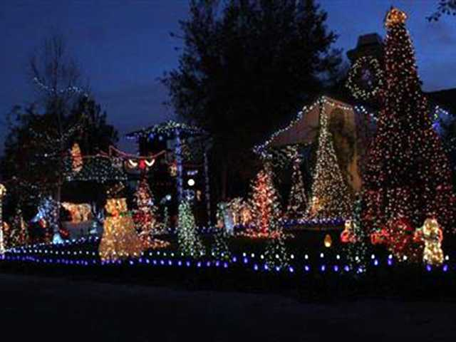 "Castaic: Holiday light show, ""Believe,"" at the Tisdell House in Castaic. Over 35,000 lights synchronized to holiday music."