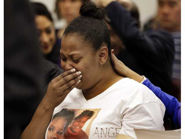 Nailah Winkfield, mother of 13-year-old Jahi McMath, cries before a courtroom hearing regarding McMath on Friday in Oakland.