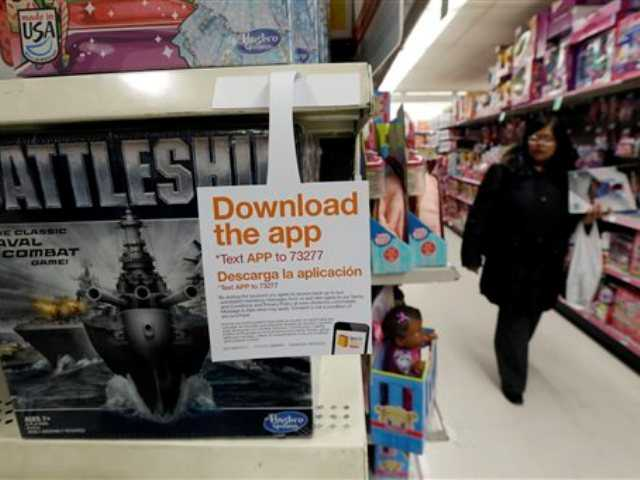 In this photo a sign for a shopping application is placed at the toys section in Kmart, in New York. Mobile shopping accounts for about 10 percent of online sales this season, but it made up half of all online traffic during Black Friday weekend, according to IBM Benchmark, which did not give dollar amounts.