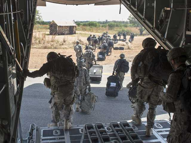 In this photo taken Wednesday, Dec. 18, 2013 and released by the U.S. Air Force, soldiers of the East Africa Response Force (EARF), a Djibouti-based joint team assigned to Combined Joint Task Force-Horn of Africa, depart from a U.S. Air Force C-130 Hercules in Juba, South Sudan to support with an ordered departure of personnel from the city. Gunfire hit three U.S. military CV-22 Osprey aircraft Saturday, Dec. 21, 2013 trying to evacuate American citizens in Bor, the capital of the remote region of Jonglei state in South Sudan, that on Saturday became a battle ground between South Sudan's military and renegade troops, officials said, with four U.S. service members wounded in the attack.