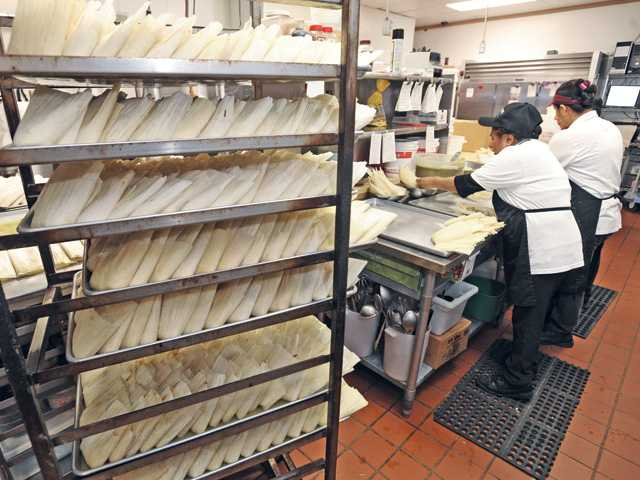 Pans of 90 tamales stand on a rack ready for steaming at Jazmin's Bakery. Signal photo by Dan Watson
