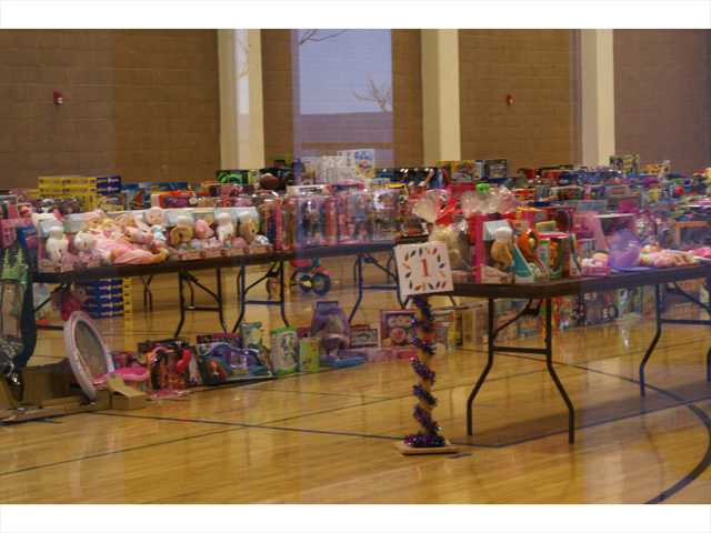 Thousands of toys are arranged for kids attending Sunday's annual Michael Hoefflin Foundation & Golden Valley High School Holiday Party for Kids with Cancer.  The children were given a blanket and told to select one toy from each of three tables. Signal photo by Jim Holt.