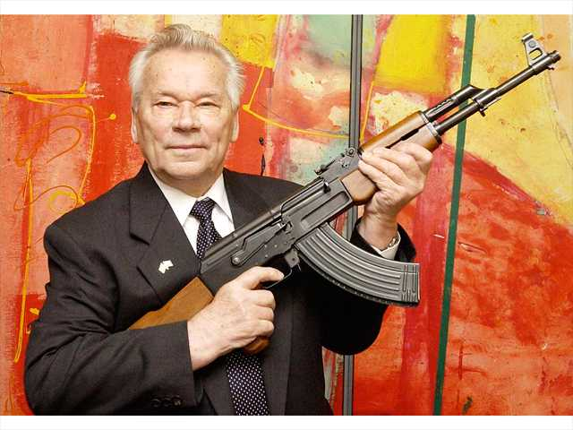 "In this July 2002 file photo, Russian weapon designer Mikhail Kalashnikov presents his legendary assault rifle to the media while opening the exhibition ""Kalashnikov - legend and curse of a weapon"" at a weapons museum in Suhl, Germany."