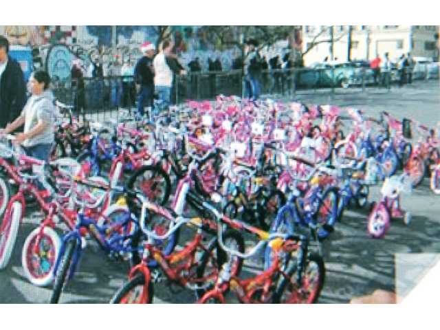 Fifty brand new bicycles were donated to the Skid Row Toy Run this year by Canyon Country Chapter 101 of the Boozefighters Motorcycle Club. Photo courtesy of Betsy Huelskamp.