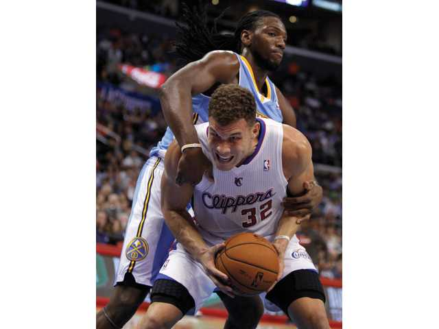 Denver Nuggets forward Kenneth Faried, above, wraps up Los Angeles Clippers forward Blake Griffin (32) on Saturday in Los Angeles.