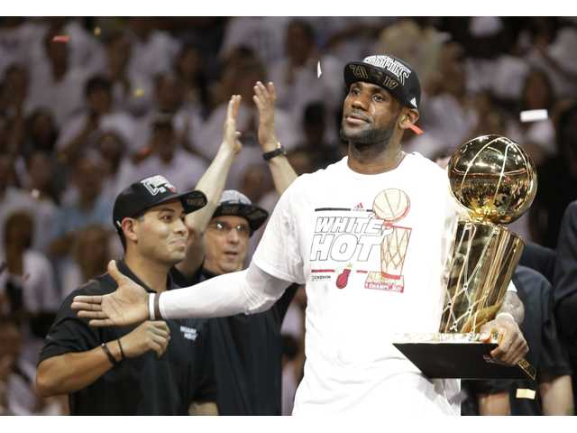 Miami Heat small forward Lebron James became the third basketball player to win the Associated Male Athlete of the Year.