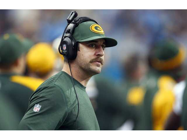 In this Nov. 28 file photo, Green Bay Packers quarterback Aaron Rodgers watches from the sidelines in Detroit.