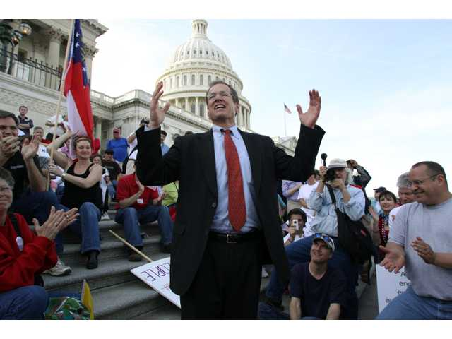 In this March 20, 2010 file photo, Rep. Jack Kingston, R-Ga., speaks to people demonstrating against the health care bill.