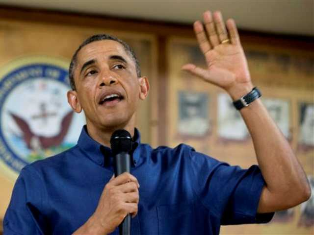 President Barack Obama speaks to members of the military and their families in Anderson Hall at Marine Corps Base Hawaii, Wednesday, Dec. 25, 2013, in Kaneohe Bay, Hawaii.