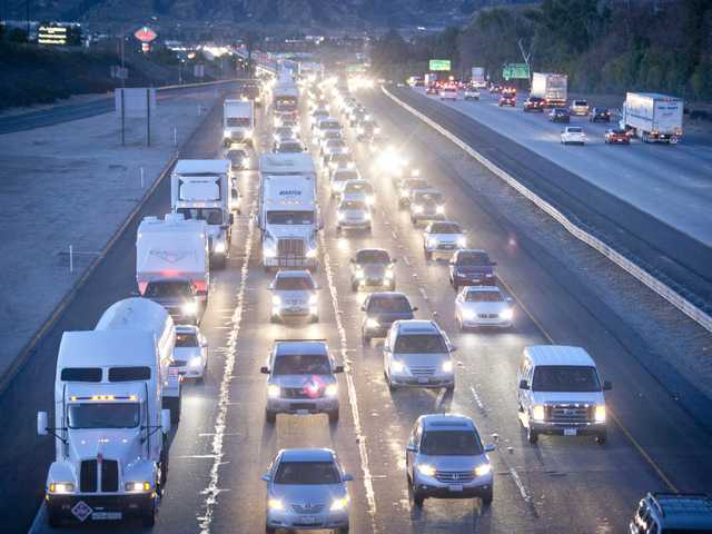 Traffic backs up on the Interstate 5 North near Six Flags Magic Mountain as drivers return to the valley following the Christmas Holiday.