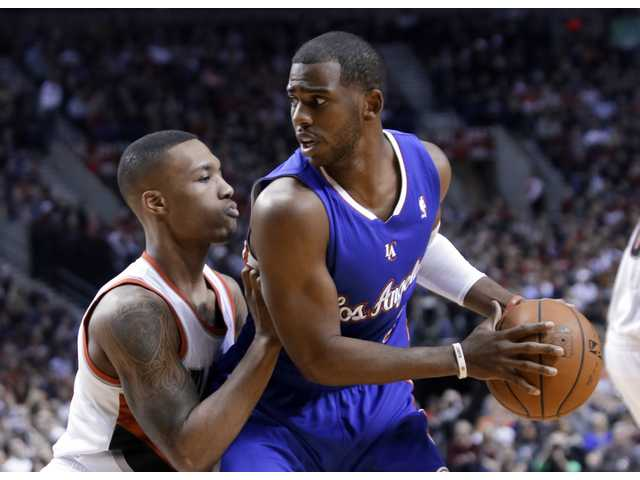 Los Angeles Clipper Chris Paul (right) is guarded by Portland's Damian Lillard on Thursday night in Portland.