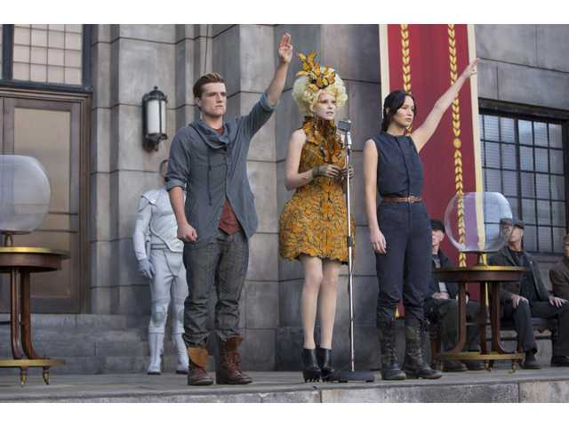 "This image released by Lionsgate shows, from left, Josh Hutcherson, Elizabeth Banks and Jennifer Lawrence in a scene from, ""The Hunger Games: Catching Fire."""