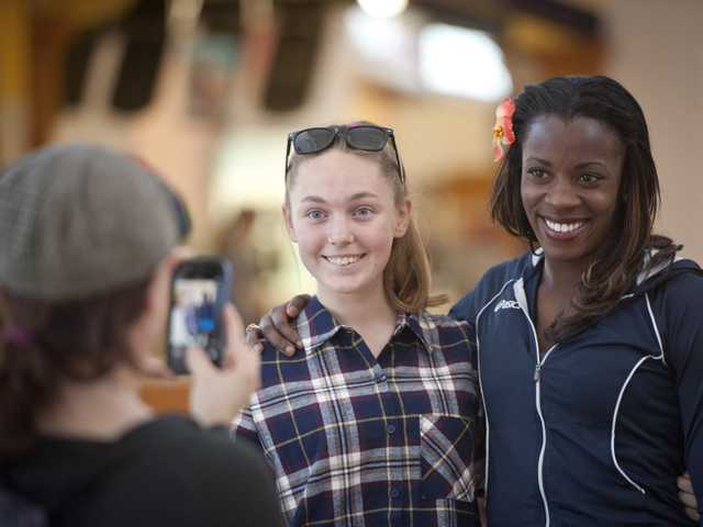Christine Hupalo takes a picture of her daughter, Ekaterina Hupalo, with five-time U.S. National Champion and 2012 Olympian Alysia Montano at the Westfield Valencia Town Center on Friday. Signal photo by Charlie Kaijo