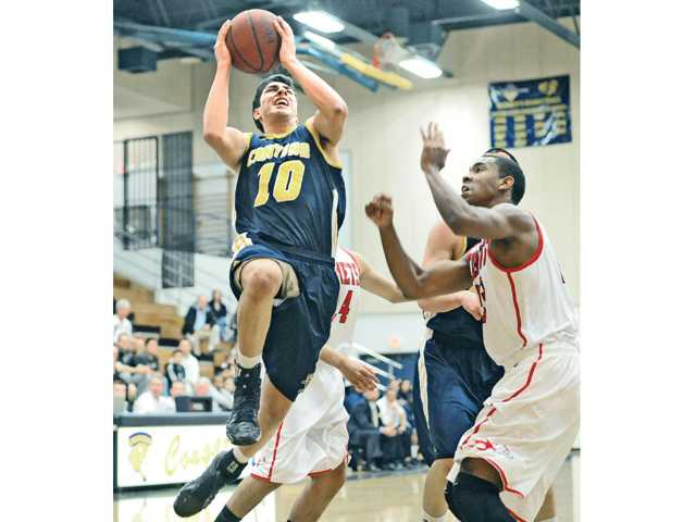 College of the Canyons' Roman Delgado goes up for a shot as Palomar's Jeremy Franklin defends Friday at COC.