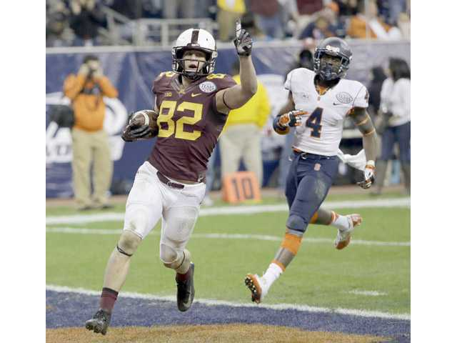 Minnesota wide receiver and Canyon graduate Drew Wolitarsky (82) celebrates after scoring a touchdown against Syracuse in the Texas Bowl on Friday in Houston.