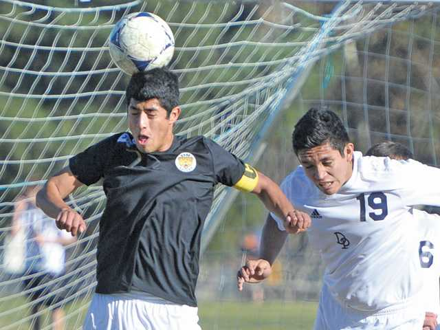 Golden Valley's Billy Torres, left, heads the ball toward the goal against Dos Pueblos Hart High on Saturday.
