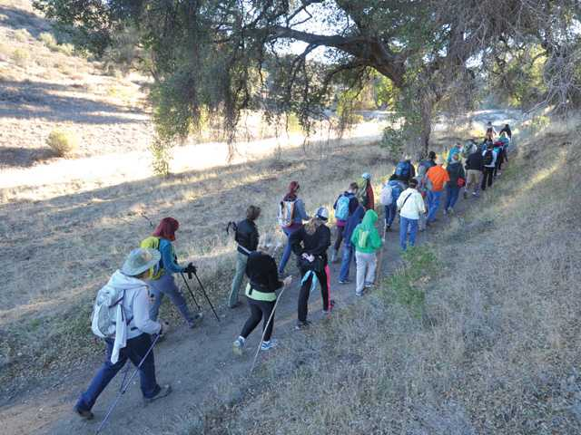 About 35 hikers turned out Saturday for a Community Hiking Club hike through the Golden Valley Ranch Open Space. Signal photo by Dan Watson