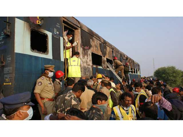 Fire on express train in India kills at least 26